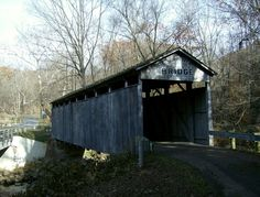 The Teegarden-Centennial Covered Bridge, constructed primarily of white oak is of Multiple King Post design spanning 67 feet. It was built nearly 100 years after the birth of the nation. Located on Eagleton Road, just off Teegarden Road, it is still at its original location, spanning the Middle Fork of the Little Beaver Creek in Eagleton's Glen Park. The bridge is a 500 foot cycle downhill from the Little Beaver Greenway Trail.
