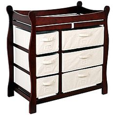 @Overstock.com - Badger Basket Cherry 6-basket Baby Changing Table - This Badger Basket changing table keeps everything tidy and concealed for a clean look in the nurseryThe changing area has safety rails on all four sides for complete safetyThis table has six baskets to help you stay organized    http://www.overstock.com/Baby/Badger-Basket-Cherry-6-basket-Baby-Changing-Table/4670576/product.html?CID=214117  $116.09