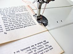 paper_sewing: How to turn old book pages into place mats, etc. I was thinking that this would be cool to make for a word work center, etc. Have the kids find words on the pages, etc.