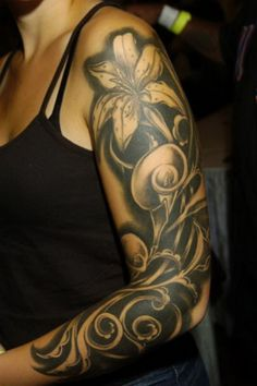 Orchid And Swirls Sleeve Tattoo #tattooideaslive #tattoo #orchid #sleeve