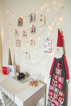 This whimsical layout  lets you hang holiday cards along fairy lights and will brighten up any room with Christmas cheer.