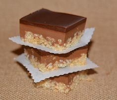 CARAMEL PEANUT BUTTER KRISPY BARS TOPPED WITH A THICK, CHOCOLATE GLAZE