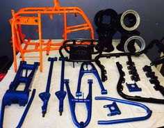 Powder coated ATV parts. Learn to powder coat at http://www.powdercoatguide.com/