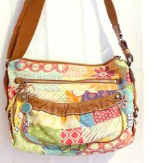 Authentic Fossil Leather & Canvas Purse Authentic Fossil Leather & Canvas Multi-Color Floral Purse. Very roomy large, beautiful shoulder &/or Crossbody bag with many compartments. Excellent condition, never used.  {Bundles: Buyer Pays IF any additional shipping expenses are incurred} Fossil Bags