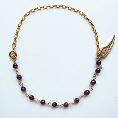 Natural little round garnet, candy color gemstone bracelet with 24 K gold plated wing charm, multi-color available, FREE shipping #christmas #xmas #halloween #highquality #affordable #freeshipping #bead #beads #gem #gems #gemstone #gemstones #jewelry #jewellery #jewelrymaking #jewelrysupplies #jewelrysupply #etsy #farragem #design #designer #handcrafted #handmade #ring #necklace #earrings #bracelet #pendant Ring Necklace, Beaded Necklace, Earrings, Gemstone Bracelets, Gem S, Candy Colors, Jewelry Supplies, Garnet, Charmed