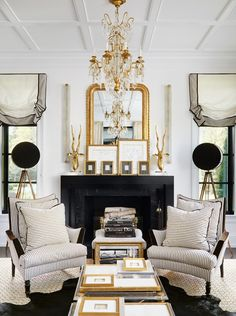 Parisian-chic salon style Living Room by interior designer Megan Winters, via @sarahsarna.