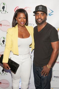 Kandi Burruss wears yellow jacket with white pants and tank top with Todd Tucker