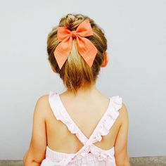 "our solid chambray bow in ""coral"" releases Sunday along with ""cream"" and ""sherbet"" // 10am mountain time 🌿 perfect summer pinafore by @mabokids"