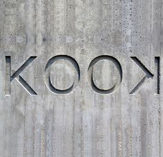 KOOK restaurant signage | Italy, concrete, tonal, engraved, integrated