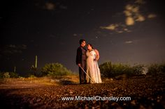 bride and groom formal portrait with light sabers under starts in a galaxy far far away at Star Wars themed wedding at Saguaro Buttes wedding venue in Tucson AZ Arizona by Michael Chansley Photography wedding photographer Tucson ideas cactus saguaro desert idea cute fun romantic letters gift pond lake sunset views couple