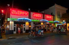 Pedicab passing in front of Sloppy Joe's Bar, Duval Street, Key West, Florida Keys, Florida - Photo by Blaine Harrington III