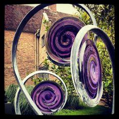 Steel and glass garden sculpture
