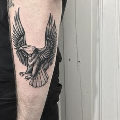 bw flying eagle tattoo on the forearm