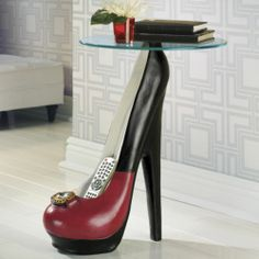 High Heel Table from Midnight Velvet.     Sassy and chic, this table is a witty way to express your love of shoes. Tempered glass top on resin base with faceted accent.