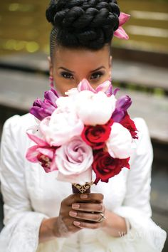 Loving this hairdo by Khamit Kinks. Photo by petronella photography.  bouquet by makini regal designs.