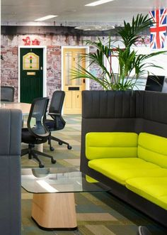These grey and lime green high backed sofas provide space for informal meetings and huddles. In the background you can see black swivel chairs and desks for independent working and the doorway to the formal meeting spaces - disguised as residential front doors! No wonder this office design for Splunk was voted the coolest office in the UK by Management Today.