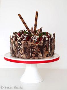 Chocolate cake. Choc shard side decoration wrap.  Choc dipped strawberries.. Wafer sticks.
