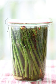 Pickled Skinny Asparagus Snacks. They are crisp, fresh, tangy, garlicky and have just a hint of hot pepper and make super yummy snacks.