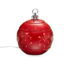 Let this classic Christmas icon fill your home with wonderful fragrance. Our electric ceramic warmer uses a warming plate to release the fragrance of Scent Plus® Melts, or scented oil,  sold separately. Hidden LED provides a welcoming glow. Includes three glazed ceramic pieces. Use without the lid for a stronger scent. 6 $35.00
