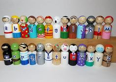 The A-Z of Peg Dolls Set Alphabet Peg Dolls Educational by rainbowPegDolls Materials: wooden peg doll, non toxic acrylic paint, non toxic varnish...