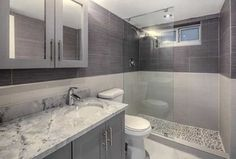 Contemporary 3/4 Bathroom with Undermount sink, Complex Granite, frameless showerdoor, Glass panel, Flat panel cabinets