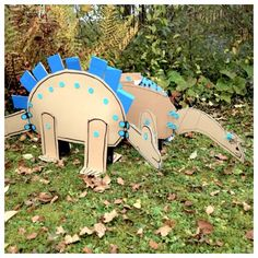 Cardboard dinosaurs with hinged necks and tails made with Makedo