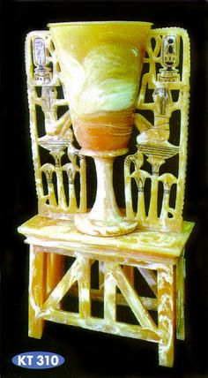 *TOMB of TUTANKHAMUN-Burial Chamber: The first is a very ornate lamp which shows on either side the god Heh grasping the ankh sing (KT 301).