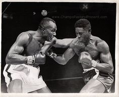 Ezzard Charles VS Jersey Joe Walcott  December 5, 1949 Ezzard Charles defeats Jersey Joe Walcott for the heavyweight boxing title.