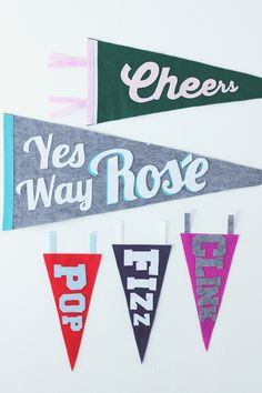 Craft these playful happy hour-inspired pennants from brightly colored felt for a fun bar cart decoration.