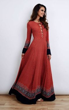 Red navy border print lace up maxi dress. Features long sleeves lace up detail at the chest with flared semi-sheer maxi length skirt. As seen on Kate Middleton.