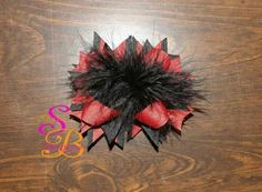 Black and red boutique hair bow with feathers made by Shana's Boutique