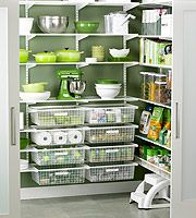 """We've got elfa in the pantry, laundry room, living room/desk, and in the spare room closet for my """"craft center."""" We LOVE Elfa! They design it for free and David installs it. We shop the sale each winter!"""