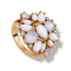 A fabulous goldtone statement ring with a cluster of white acrylic stones in floral design. Stones are marquis and teardrop in shape with round clear glass stones around the outside. Regularly $16.99, buy Avon Jewelry online at http://eseagren.avonrepresentative.com