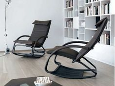 Bonaldo Swing rocking armchair  The delicate curving invites you to take a break. Swing, a rocking armchair featuring a contemporary design which, with a simple movement, turns into a chaise longue. The frame is made of painted or chromed steel with shrink-resistant rubber padding; the upholstery is in fabric, skay (eco-leather) or leather.  http://www.industryinterior.com/en/prod/living-room/armchair/bonaldo-swing-rocking-armchair.html