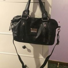 Nicole Miller purse! Black Nicole Miller purse. Very comfortable straps. I didn't even wear this once. Bought it and was gifted a Michael Kors purse the next day. Still a good purse(: let me know if you have any questions !! Nicole by Nicole Miller Bags
