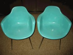 two midcentury modern fiberglass chairs in turquoise, opposite of my acrylic desk.