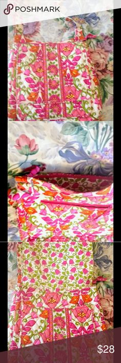 Vera Bradley laptop bag in pink floral. Vera Bradley laptop bag in pink floral. Fantastic bag I used it for long car trips and it carried my Tablet and or laptop + my Kindle Fire + a paperback book + chargers earbuds, lip gloss pen paper etc!!! Selling as my larger new laptop won't fit!!!  Great condition non smoking home. Vera Bradley Bags Laptop Bags