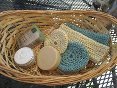 100% cotton hand crochet washcloth and facial puff made by Leslie Abrams, organic travel candle in linen scent and almond soap. Donated by the artist.