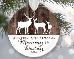 How do you like this fun, rustic, deer and (faux/fake) wood ornament? Bring joy to the new parents as they receive this Personalized Christmas Ornament that reads, Our first Christmas as Mommy & Daddy or Mom and Dad.Ceramic ornaments make fabulous Christmas gifts and this one will be a treasured keepsake for years to come! For a custom gift, upgrade packaging to a gift box and have it mailed directly to the recipients by changing the ship-to address at checkout.  Grandparents…