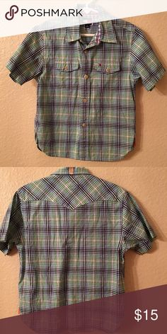 Boys Tommy Hilfiger Button up shirt. Size 6. CUTE! Boys Tommy Hilfiger Button up shirt. Size 6. Absolutely LOVR this shirt. I wish it still fit my son because it's SO Awesome! It's still in EXCELLENT condition. Just needs to be ironed & it's good to go! You will LOVE this shirt. I Know I definitely do! But my sweet boy is getting big. :/ Tommy Hilfiger Shirts & Tops Button Down Shirts