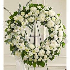 Wreath Arrangement of White Flowers + Flowers: 60 Stem (Incl Roses, Daisies, Lilies & Carnations). #FlowersDeliveryIndia #MumbaiFlowers #MayaFlowers #IndiaFlorist