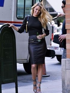 Blake Lively in black leather pencil skirt.