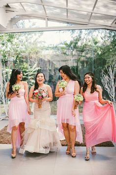The bridesmaids wore stylish gowns in pink.