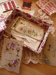 display pretty vintage postcards in floral boxes