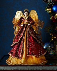 Shop Burgundy & Gold Angel at Horchow, where you'll find new lower shipping on hundreds of home furnishings and gifts. Ghost Of Christmas Past, Angel Christmas Tree Topper, Christmas Angels, Red Christmas, Christmas Crafts, Christmas Decorations, Miniature Christmas, Christmas Wedding, Christmas Ornament