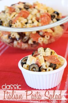 Classic Italian Pasta Salad - Tender salad macaroni with slices of pepperoni, cheese, & black olives topped with Italian dressing & grated parmesan cheese.  This is a crowd pleaser pasta salad to bring to any gathering from DessertNowDinnerLater.com