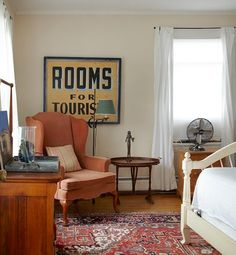 "Old signs offer a big bang for your buck, especially considering how much a framed print or painting of equal size would cost. Have fun searching for that just-right wall decor—""Rooms for Tourists"" sign hanging in a guest bedroom."