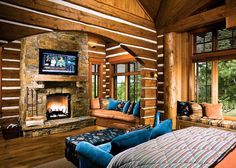 log home bedrooms   master bedroom with fireplace and arched wall