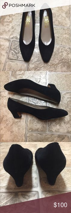 "Salvatore Ferragamo suede pumps Gorgeous black suede , low heel classic pumps. Heel is 1.75"". Small flaw inside front of left shoe is not noticeable when worn and not unless you look inside shoe (see last picture). Other than the small flaw mentioned, these shoes are in excellent condition and were worn no more than 3 times. Size is 9.5 AA Salvatore Ferragamo Shoes Heels"