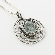 Aquamarine Rough set in solid sterling silver artisan crafted pendant. DETAILS: * Aquamarine Rough Pendant * 5.3 g total weight * Set in SOLID .925 Sterling Silver * Stamped .925 * Measures approximat #SilverJewelry